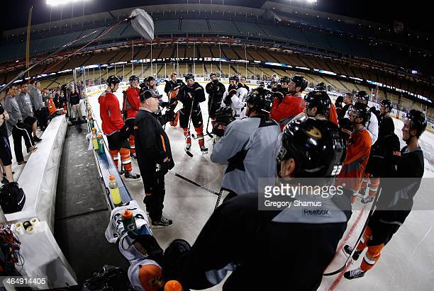 Head coach Bruce Boudreau of the Anaheim Ducks speaks to his team during practice for the 2014 Coors Light NHL Stadium Series against the Los Angeles...