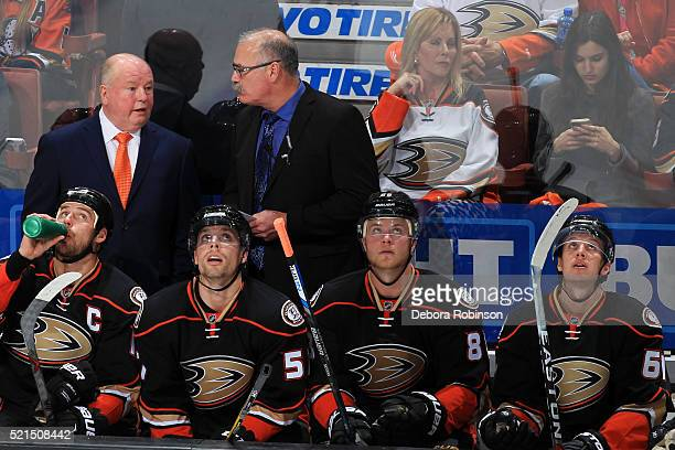 Head coach Bruce Boudreau of the Anaheim Ducks talks with Assistant coach Paul MacLean during Game One of the Western Conference Quarterfinals...