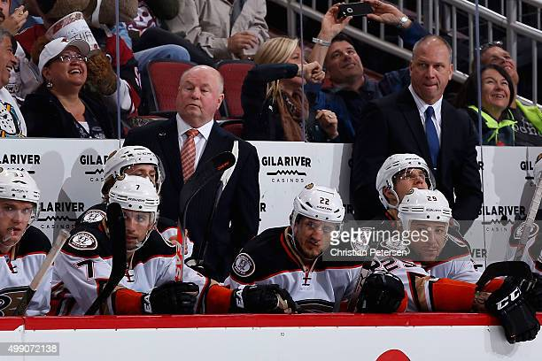 Head coach Bruce Boudreau of the Anaheim Ducks watches from the bench during the NHL game against the Arizona Coyotes at Gila River Arena on November...