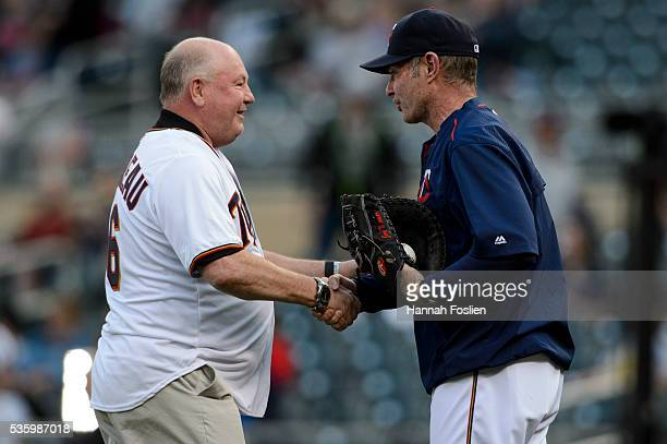 Head coach Bruce Boudreau of the Minnesota Wild and manager Paul Molitor of the Minnesota Twins shake hands after Boudreau delivered a ceremonial...