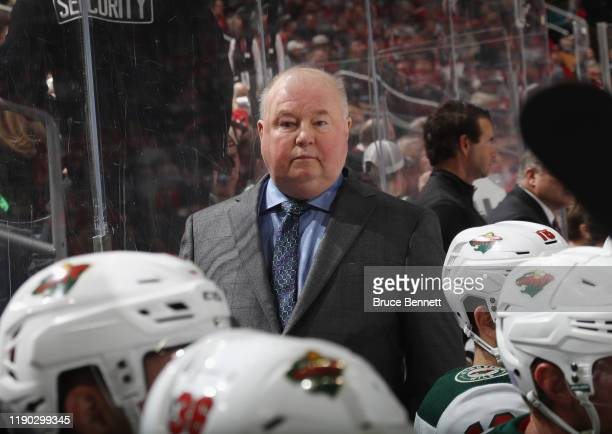 Head coach Bruce Boudreau of the Minnesota Wild handles bench duties against the New Jersey Devils at the Prudential Center on November 26 2019 in...