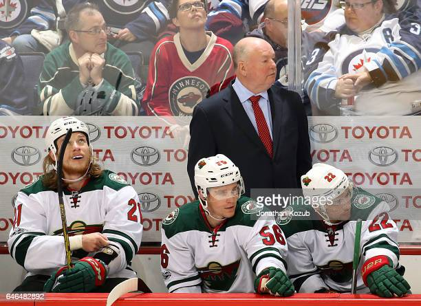 Head Coach Bruce Boudreau of the Minnesota Wild looks on from the bench during third period action against the Winnipeg Jets at the MTS Centre on...