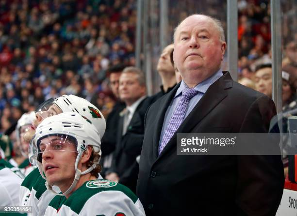 Head coach Bruce Boudreau of the Minnesota Wild looks on from the bench during their NHL game against the Vancouver Canucks at Rogers Arena March 9...