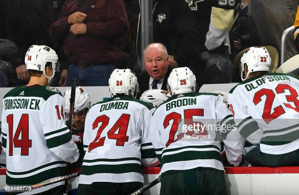 Head coach Bruce Boudreau of the Minnesota Wild talks to his players during the game against the Pittsburgh Penguins at PPG Paints Arena on January...