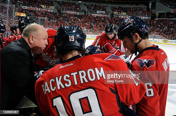 Head coach Bruce Boudreau of the Washington Capitals talks to his team during a timeout against the Phoenix Coyotes at the Verizon Center on November...