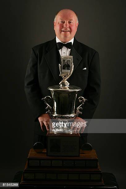 Head coach Bruce Boudreau of the Washington Capitls poses with the Jack Adams Award during the 2008 NHL Awards at the at the Elgin Theatre on June...