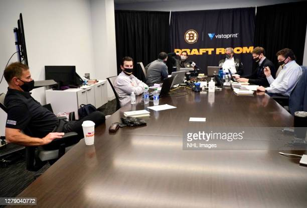 Head coach Bruce Cassidy and Boston Bruins team personnel attend rounds 27 of the 2020 NHL Entry Draft at the Warrior Ice Arena on October 07 2020 in...