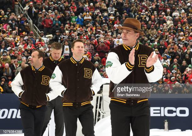 Head Coach Bruce Cassidy of the Boston Bruins claps his hands as he makes he and his assistant coaches make their way to the bench for the 2019...