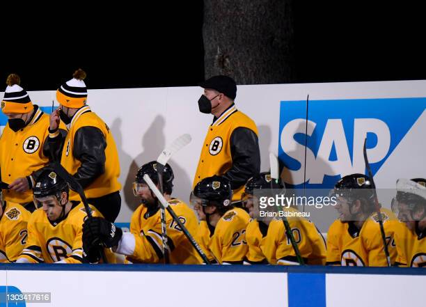 Head coach Bruce Cassidy of the Boston Bruins is seen on the bench with his team while they play against the Philadelphia Flyers during the third...