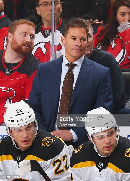 Head coach Bruce Cassidy of the Boston Bruins looks on against the New Jersey Devils during the game at Prudential Center on November 22 2017 in...