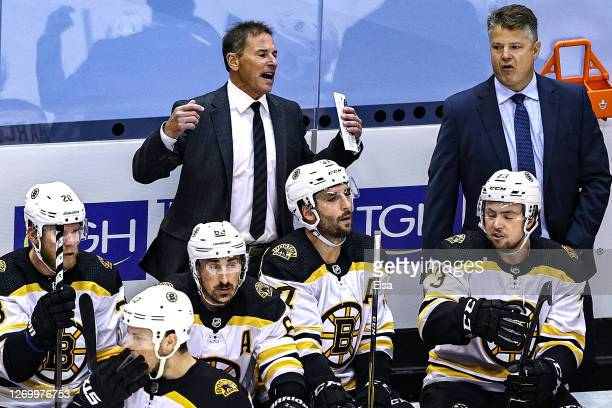 Head coach Bruce Cassidy of the Boston Bruins reacts against the Tampa Bay Lightning during the first overtime period in Game Five of the Eastern...