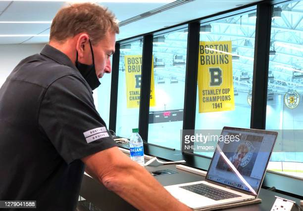 Head coach Bruce Cassidy of the Boston Bruins speaks to the 58th overall pick Mason Lohrei on a zoom call during rounds 27 of the 2020 NHL Entry...