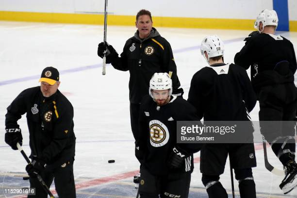 Head coach Bruce Cassidy of the Boston Bruins talk to his team during a practice session ahead of Game Three of the 2019 NHL Stanley Cup Final at...