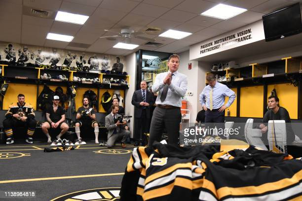 Head Coach Bruce Cassidy of the Boston Bruins talks to the team after the win against the Toronto Maple Leafs in Game Seven of the Eastern Conference...