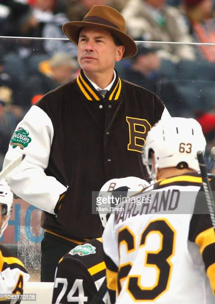 Head coach Bruce Cassidy of the Boston Bruins watches his team play against the Chicago Blackhawks in the 2019 Bridgestone NHL Winter Classic game at...