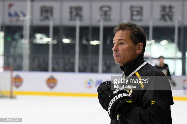 Head coach Bruce Cassidy of the Boston Bruins watches practice at the ORG AZ Rink on September 18 2018 in Beijing China