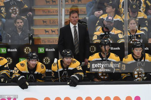 Head coach Bruce Cassidy of the Boston Bruins watches the third period against the New Jersey Devils at the TD Garden on October 13 2019 in Boston...