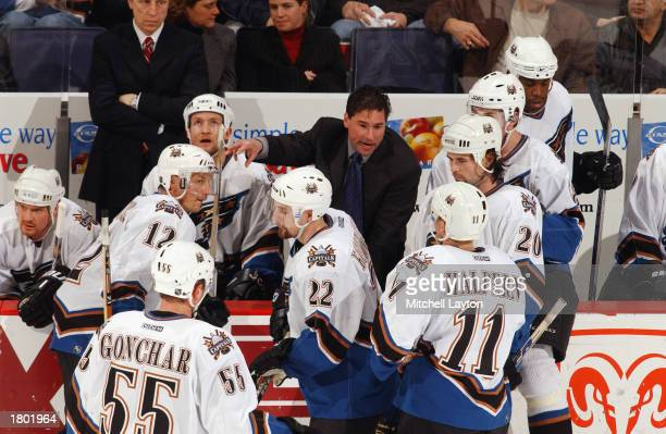 Head coach Bruce Cassidy of the Washington Capitals gives instructions to his team from the bench against the New Jersey Devils at the MCI Center on...