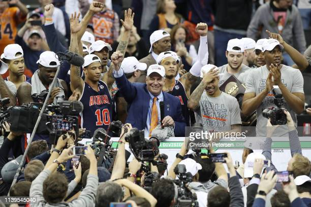 Head coach Bruce Pearl and the Auburn Tigers celebrate defeating the Kentucky Wildcats 7771 in overtime during the 2019 NCAA Basketball Tournament...