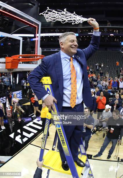 Head coach Bruce Pearl of the Auburn Tigers cuts the net after defeating the Kentucky Wildcats 7771 in overtime during the 2019 NCAA Basketball...