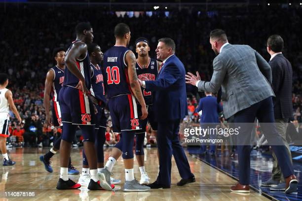 Head coach Bruce Pearl of the Auburn Tigers huddles with his team in the second half against the Virginia Cavaliers during the 2019 NCAA Final Four...