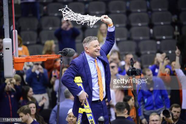 Head Coach Bruce Pearls of the Auburn Tigers cuts down the net after defeating the Kentucky Wildcats in the Elite Eight round of the 2019 NCAA Photos...