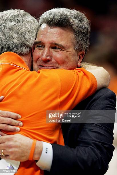 Head coach Bruce Weber of the Illinois Fighting Illini hugs his brother David Weber as they celebrate after victory over the Arizona Wildcats in the...