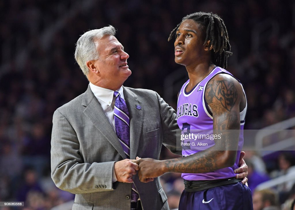 Head coach Bruce Weber (L) of the Kansas State Wildcats talks with Cartier Diarra #2 during the second half against the TCU Horned Frogs on January 20, 2018 at Bramlage Coliseum in Manhattan, Kansas.