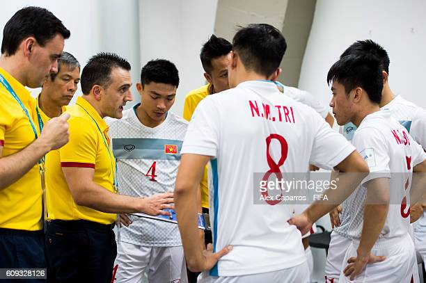 Head Coach Bruno Garcia Áof Vietnam gives instructions to his players in the dressing room before the FIFA Futsal World Cup Round of 16 match between...