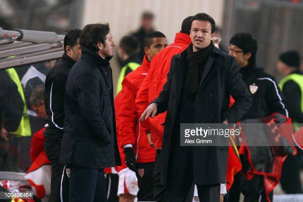 Head coach Bruno Labbadia and manager Fredi Bobic of Stuttgart react after the UEFA Europa League match round of 32 second leg between VfB Stuttgart...