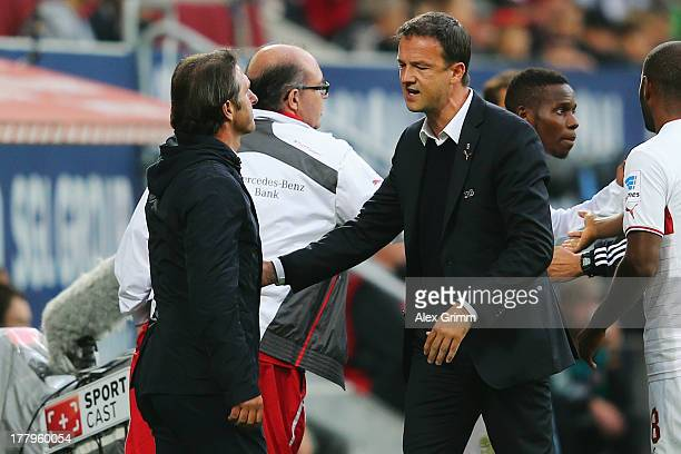 Head coach Bruno Labbadia and manager Fredi Bobic of Stuttgart react during the Bundesliga match between FC Augsburg and VfB Stuttgart at SGL Arena...