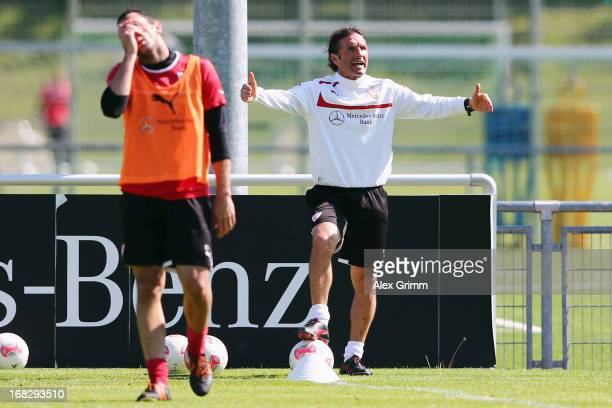 Head coach Bruno Labbadia gestures as Cristian Molinaro reacts during a VfB Stuttgart training session at the club's premises on May 8 2013 in...
