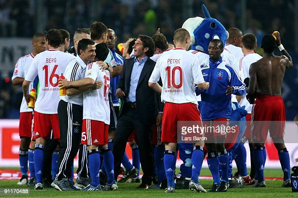 Head coach Bruno Labbadia of Hamburg celebrates with his players after winning the Bundesliga match between Hamburger SV and FC Bayern Muenchen at...