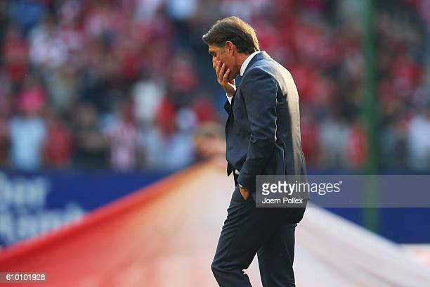 Head coach Bruno Labbadia of Hamburg reacts after the Bundesliga match between Hamburger SV and Bayern Muenchen at Volksparkstadion on September 24...