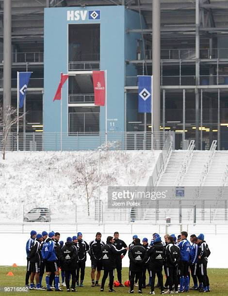 Head coach Bruno Labbadia of Hamburg talks to his team during the Hamburger SV training session at the HSH Nordbank Arena on January 12, 2010 in...