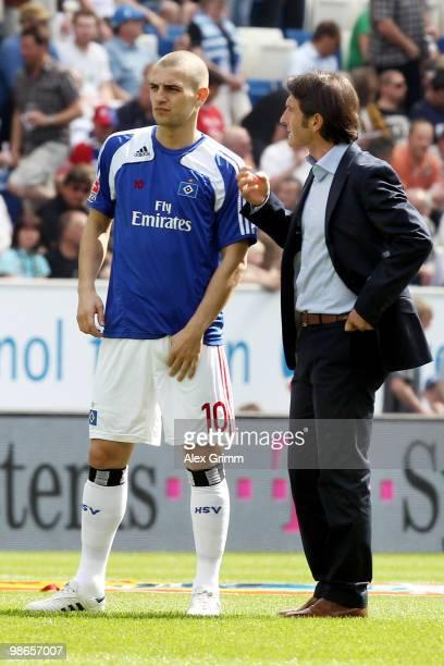 Head coach Bruno Labbadia of Hamburg talks to Mladen Petric before the Bundesliga match between 1899 Hoffenheim and Hamburger SV at the Rhein-Neckar...