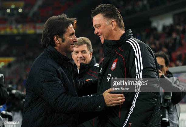 Head coach Bruno Labbadia of Stuttgart arms head coach Louis van Gaal of Muenchen during the Bundesliga match between VfB Stuttgart and FC Bayern...