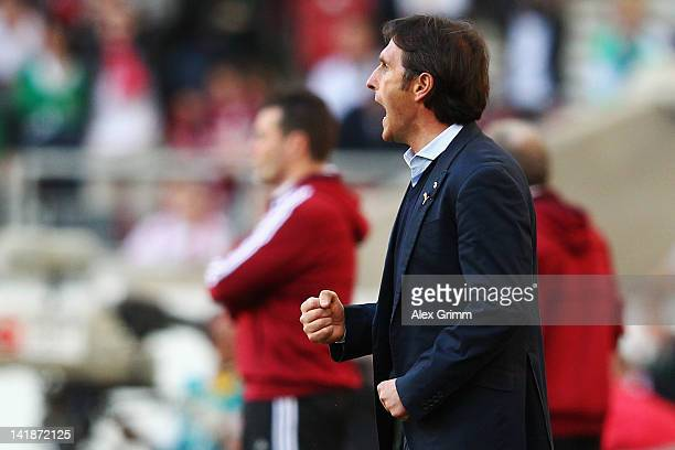 Head coach Bruno Labbadia of Stuttgart celebrates after the final whistle of the Bundesliga match between VfB Stuttgart and 1 FC Nuernberg at...