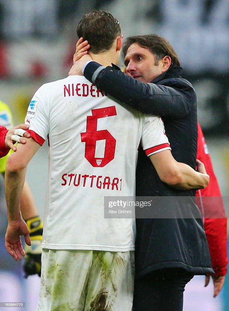 Head coach Bruno Labbadia of Stuttgart hugs Georg Niedermeier after the Bundesliga match between Eintracht Frankfurt and VfB Stuttgart at Commerzbank-Arena on March 17, 2013 in Frankfurt am Main, Germany.