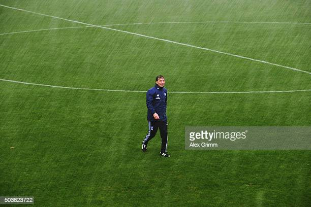 Head coach Bruno Labbadia walks in the rain during a Hamburger SV training session on day 2 of the Bundesliga Belek training camps at Sueno Deluxe...