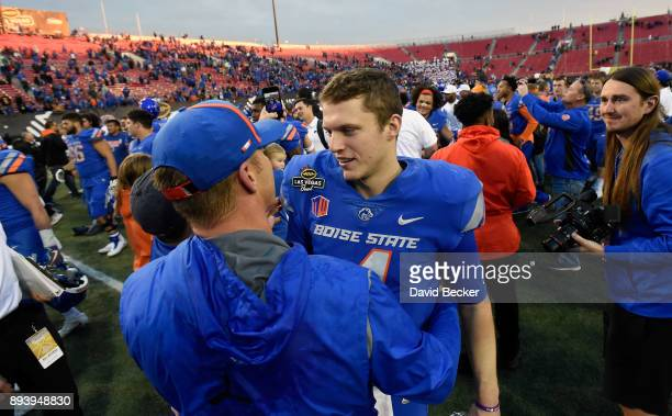 Head coach Bryan Harsin and quaterback Brett Rypien of the Boise State Broncos embrace after defeatng the Oregon Ducks in the Las Vegas Bowl at Sam...