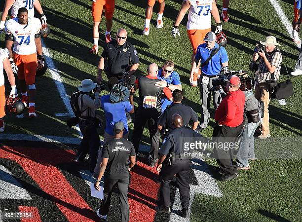 Head coach Bryan Harsin of the Boise State Broncos and head coach Tony Sanchez of the UNLV Rebels shake hands after their game at Sam Boyd Stadium on...