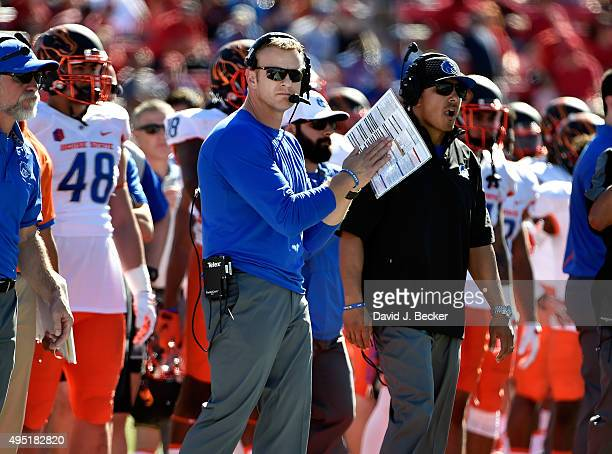 Head coach Bryan Harsin of the Boise State Broncos applauds his team during a game against the UNLV Rebels at Sam Boyd Stadium on October 31 2015 in...