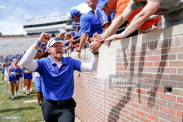 Head Coach Bryan Harsin of the Boise State Broncos celebrates with the fans after the game against the Florida State Seminoles at Doak Campbell...