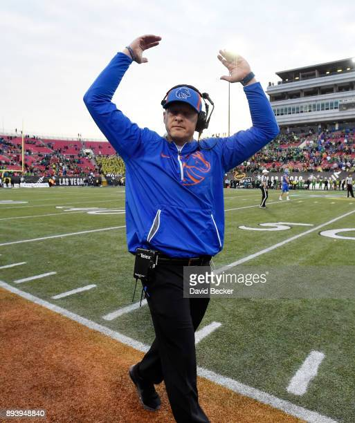 Head coach Bryan Harsin of the Boise State Broncos cheers from the sideline moments before the his team defeated the Oregon Ducks in the Las Vegas...