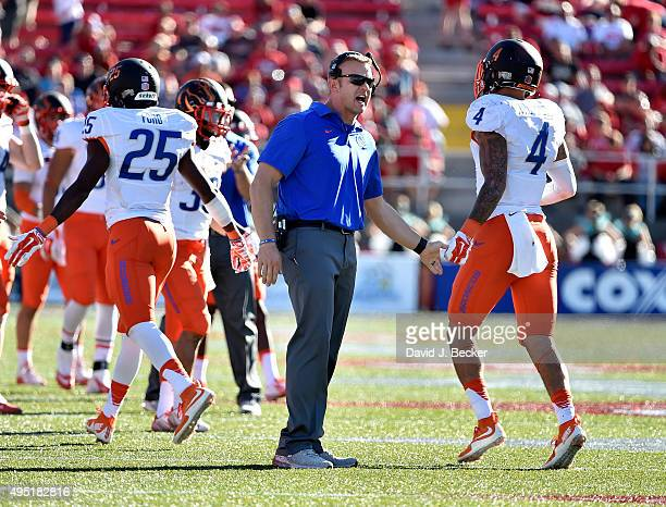 Head coach Bryan Harsin of the Boise State Broncos congratulates Darian Thompson during a game against the UNLV Rebels at Sam Boyd Stadium on October...