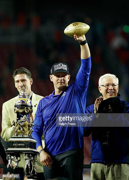 Head coach Bryan Harsin of the Boise State Broncos holds up the Fiesta Bowl trophy after the team's 3830 victory over the Arizona Wildcats in the...