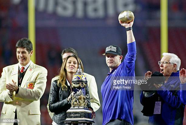 Head coach Bryan Harsin of the Boise State Broncos holds up the Vizio Fiesta Bowl trophy after the team's 3830 victory over the Arizona Wildcats in...