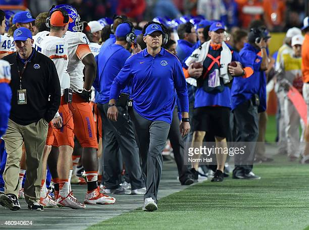Head coach Bryan Harsin of the Boise State Broncos paces up and down the sidelines during the second half in the Vizio Fiesta Bowl against the...