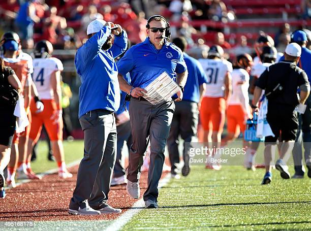 Head coach Bryan Harsin of the Boise State Broncos runs along the sideline during a game against the UNLV Rebels at Sam Boyd Stadium on October 31...
